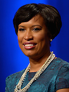 Washington, DC - January 2, 2015: Muriel Bowser listens to a speaker before taking the oath of office during the 2015 inauguration ceremony held at the Washington Convention Center, January 2, 2015. Bower became the second female mayor in the history of the District of Columbia.  (Photo by Don Baxter/Media Images International)