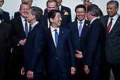 Shinzo Abe, Japan's prime minister, center, smiles as he walks out of a family photo at the Nuclear Security Summit in Washington, D.C., U.S., on Friday, April 1, 2016. After a spate of terrorist attacks from Europe to Africa, U.S. President Barack Obama is rallying international support during the summit for an effort to keep Islamic State and similar groups from obtaining nuclear material and other weapons of mass destruction. <br /> Credit: Andrew Harrer / Pool via CNP