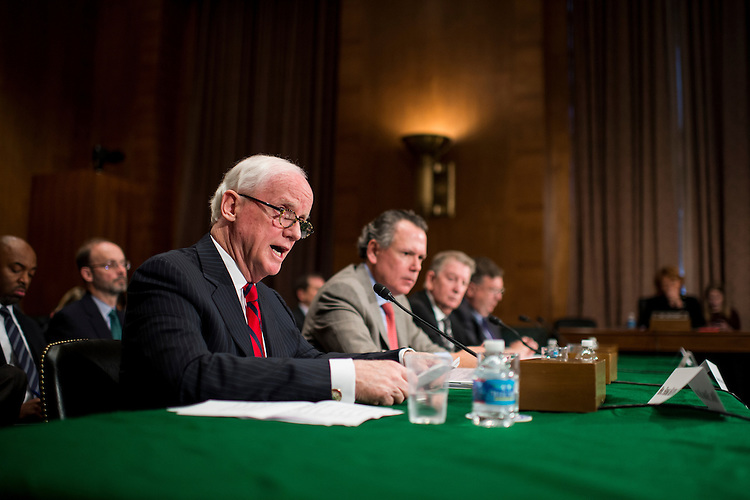 "UNITED STATES - OCTOBER 10: From left, Frank Keating, president and CEO of the American Bankers Association, Kenneth Bentsen Jr., president of the Securities Industry and Financial Markets Association; Gary Thomas, president of the National Association of Realtors; and Paul Schott Stevens, president and CEO of the Investment Company Institute, testify during the Senate Banking, Housing and Urban Affairs Committee hearing on ""Impact of a Default on Financial Stability and Economic Growth"" on Thursday, Oct. 10, 2013. (Photo By Bill Clark/CQ Roll Call)"