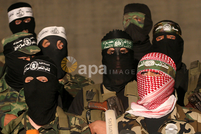 Hamas militants and other Palestinian militants group attend a press conference in Gaza  City on Sept. 2, 2010. After a day and evening in White House talks with US President Barack Obama, Israeli Prime Minister Benjamin Netanyahu and Palestinian President Mahmoud Abbas sit down together for the first of what American officials hope will be a series of meetings that lead in a year's time to an agreement on the creation of a Palestinian state. Photo by Mohammed Asad