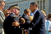 United States President Barack Obama shakes hands with a servicemember at the Pentagon Memorial following a ceremony with U.S. Secretary of Defense Robert M. Gates and Chairman of the Joint Chiefs of Staff Admiral Mike Mullen, marking the ninth anniversary of the September 11 attacks, Saturday, September 11, 2010. .Mandatory Credit: Cherie Cullen - DoD via CNP