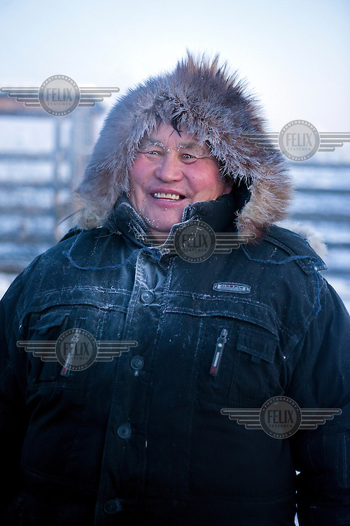 A horse breeder on his farm in Tomtor, one of the coldest inhabited places on earth having recorded some of the lowest temperatures.