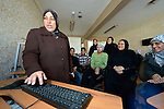 Fadya Ja'afar Al Bayati teaches a computer class in a center for Iraqi refugees in Zarqa, Jordan. The center is supported by International Orthodox Christian Charities, a member of the ACT Alliance...