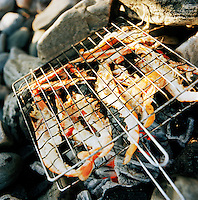 Locally caught prawns are cooked over an open fire in Knoydart in the highlands of Scotland, UK