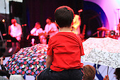A young music fan enjoying Wesli's out door concert at the Montreal International Jazz Festival