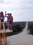 Two woman on lighthouse, Cayman Brac, Cayman Islands, British West Indies,