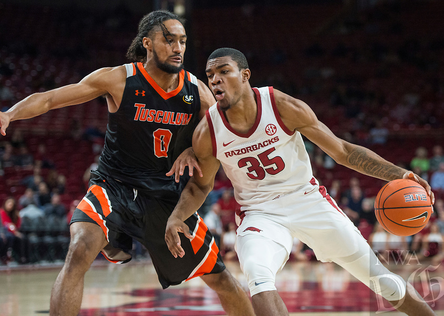 NWA Democrat-Gazette/BEN GOFF @NWABENGOFF <br /> Reggie Chaney (35) of Arkansas drives past Cam King of Tusculum in the second half Friday, Oct. 26, 2018, during an exhibition game in Bud Walton Arena in Fayetteville.