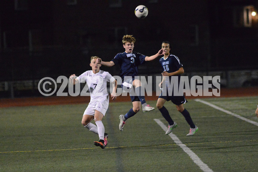 North Penn's Aiden Jerome (3) heads the ball as Lasalle's Spencer Patton (7) looks on in the first half Tuesday, November 8, 2016 at Northeast High School in Philadelphia, Pennsylvania. (Photo by William Thomas Cain)