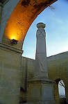 arch lamp and monument at dusk with blue sky in the Upper Barrakka Gardens in Valletta Malta