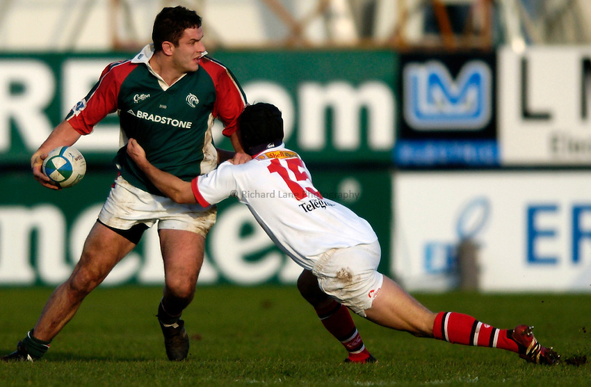 Photo: Richard Lane..Ulster Rugby v Leicester Tigers. Heinenken Cup. 11/01/2004..Will Johnson is tackled by Paddy Wallace.