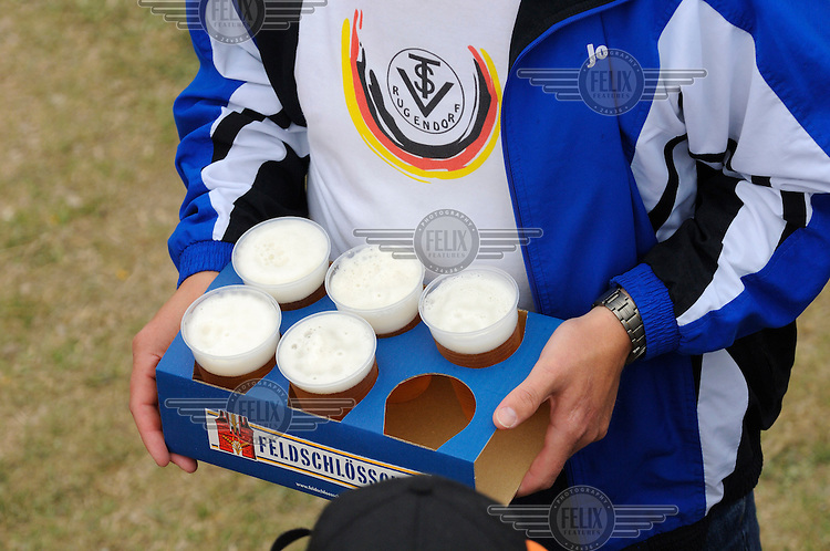German supporters load up with beer at the other official Euro 2008 football tournament: the European Championship of Mountain Villages. The tournament was held at the summer training ground of hosts FC Gspon, standing at 2008 metres above sea-level,  and surrounded by 4000 metre alpine peaks. It is the highest football pitch in Europe, and reachable only by cable car, or a long walk. Amateur league teams from eight countries took part.