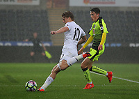 Pictured: (L-R) George Byers of Swansea City takes a shot while marked by Ryan Esst of Reading Monday 15 May 2017<br /> Re: Premier League Cup Final, Swansea City FC U23 v Reading U23 at the Liberty Stadium, Wales, UK