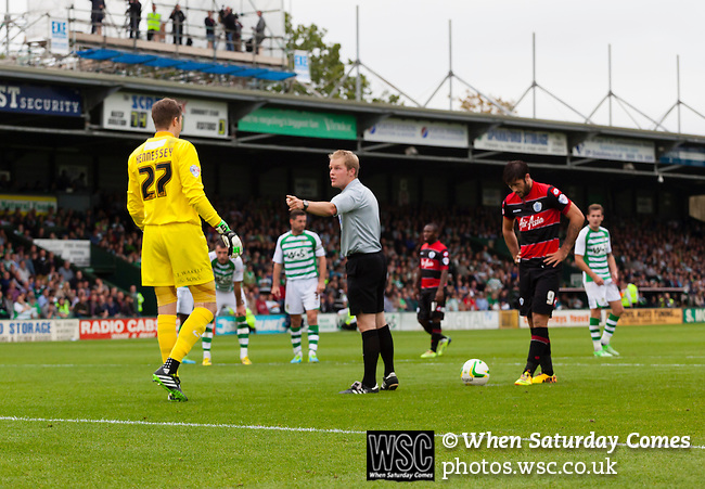 Yeovil Town 0 Queens Park Rangers 1, 21/09/2013. Huish Park, Championship. The referee sends Wayne Hennessey back to his goal while Charlie Austin prepares to take the penalty. Photo by Paul Thompson.