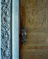 Detail of a marquetry door and marble door frame leading from the breakfast room to the dining room