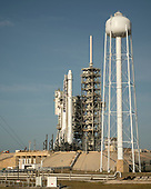 The SpaceX Falcon 9 rocket, with the Dragon spacecraft onboard, is seen shortly after being raised vertical at Launch Complex 39A at NASA's Kennedy Space Center in Cape Canaveral, Florida, Thursday, June 1, 2017. Dragon is carrying almost 6,000 pounds of science research, crew supplies and hardware to the International Space Station in support of the Expedition 52 and 53 crew members. The unpressurized trunk of the spacecraft also will transport solar panels, tools for Earth-observation and equipment to study neutron stars. This will be the 100th launch, and sixth SpaceX launch, from this pad. Previous launches include 11 Apollo flights, the launch of the unmanned Skylab in 1973, 82 shuttle flights and five SpaceX launches.<br /> Mandatory Credit: Bill Ingalls / NASA via CNP
