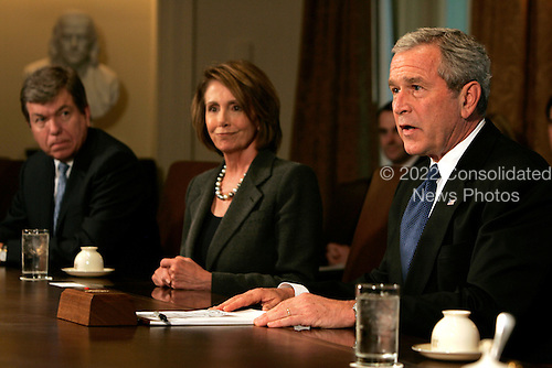 U.S. President George W. Bush (R) speaks to reporters at the top of a meeting with U.S. Congressional leaders, including Speaker of the House of Representatives Nancy Pelosi (C) and House Minority Whip Roy Blunt at the White House in Washington, D.C., USA on 11 September 2007. Bush planned to discuss the testimony of Army General David Petraeus on the Iraq war, among other issues.