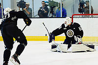 June 26, 2018: Boston Bruins defenseman Teemu Kivihalme (60) shoots on goalie Jeremy Swayman (70) during the Boston Bruins development camp held at Warrior Ice Arena in Brighton Mass. Eric Canha/CSM