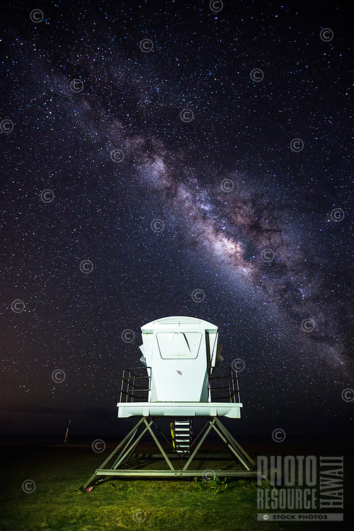 With the Milky Way falling across the night sky, a lifeguard tower looks like a spaceship ready to take off at a beach in Kekaha, Kaua'i.
