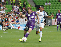 Denis Kramar  is challenged by David Williams during the  A-League soccer match between Melbourne City FC and Perth Glory at AAMI Park on February 22, 2015 in Melbourne, Australia.