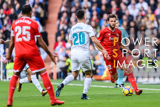 Franco Vazquez of Sevilla FC (R) in action against Marco Asensio of Real Madrid (C) during the La Liga 2017-18 match between Real Madrid and Sevilla FC at Santiago Bernabeu Stadium on 09 December 2017 in Madrid, Spain. Photo by Diego Souto / Power Sport Images
