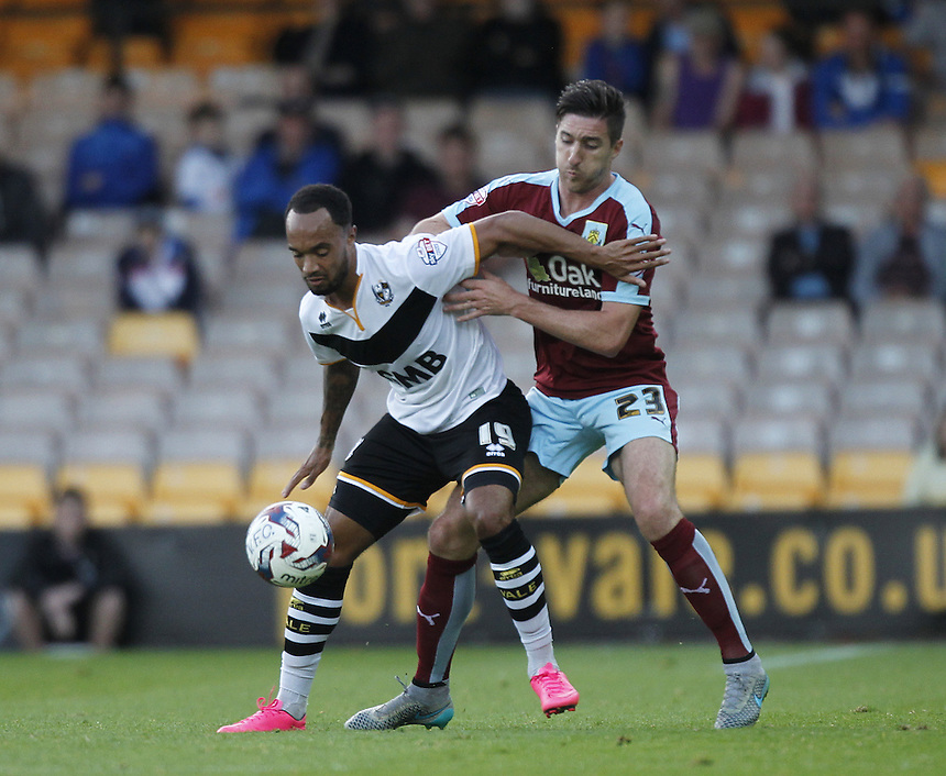 Burnley's Stephen Ward battles with  Port Vale's Byron Moore<br />
