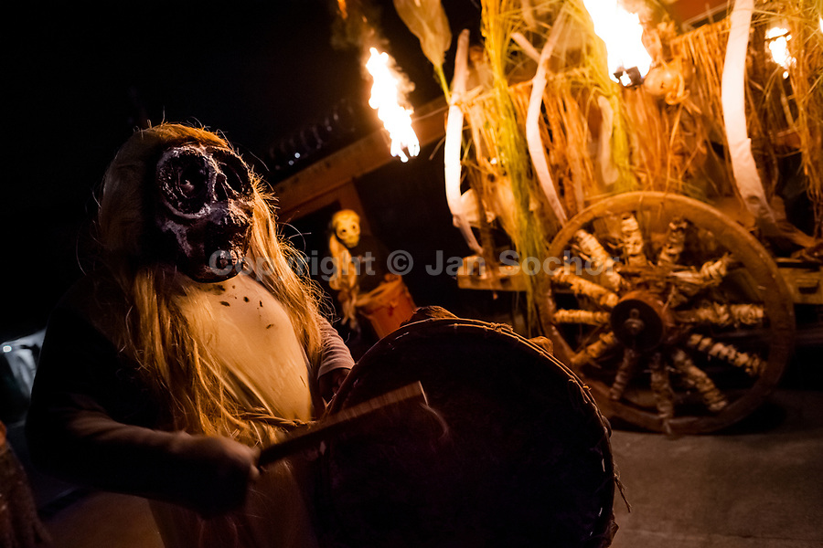 A Salvadoran man, wearing a skull mask, plays drum during the La Calabiuza parade at the Day of the Dead celebration in Tonacatepeque, El Salvador, 1 November 2016. The festival, known as La Calabiuza since the 90s of the last century, joins Salvador's pre-Hispanic heritage and the mythological figures (La Sihuanaba, El Cipitío, La Llorona etc.) collected from the whole Central American region, together with the catholic All Saints Day holiday and its tradition of honoring the dead relatives. Children and youths only, dressed up in scary costumes and carrying painted carts, march from the local cemetery to the downtown plaza where the party culminates with music, dance, drinking and eating pumpkin (Ayote) with honey.