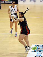 29.09.2014 Eastern Waikato's Pania Monk in action during the Counties Manukau v Eastern Waikato duing the Lion Foundation Netball Champs at the Trusts Stadium in Auckland. Mandatory Photo Credit ©Michael Bradley.
