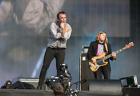 Frontman Samuel T Herring of Future Islands with William Cashion Guitarist of Future Islands during British Summertime Music Festival at Hyde Park, London, England on 18 June 2015. Photo by Andy Rowland.