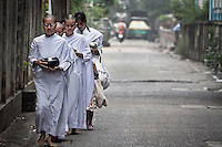 "Mae Chees clad in white robes walk silently in the early morning light, holding out their alms bowls as they go out to the neighborhood streets to collect charity. Vanished by centuries the lineage of ""Bhikkhu?nii"" (Order of Nuns) has been brought to the ongoing Thai society's debate. White-clad thai nuns, who keep the eight precepts and have their heads and eyebrows shaved are known as the lon-existing ""mae chees"" (low category to call the lay nuns). Females who have turned to religous life, as renunciants, live ostracized and marginalized by the Sangha (Buddhist community) and Thai society, denying them full access to the monastic life as well as rights and support from the government. Today nunhood is not recognized by any asian country belong to the Theravada Buddhist order. Most of the eight precept holders live in temples run by male abbots, at the shadow of the monks; with the exceptional existence of a few para-monastic institutions as the Sathira Dhammasathan meditation centre, where ""mae chees"" are not allow to held a temple, but not denied to practice the spiritual life."