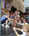 """Kerry Butler, Aaron Tveit (Catch Me If You Can) & fans - Broadway Barks Lucky 13th Annual Adopt-a-thon - A """"Pawpular"""" Star-studded dog and cat adopt-a-thon on July 9, 2011 in Shubert Alley, New York City, New York with Bernadette Peters and Mary Tyler Moore as hosts.  (Photo by Sue Coflin/Max Photos)"""