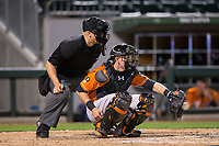 Norfolk Tides catcher Chance Sisco (23) catches a pitch as home plate umpire Chris Segal looks on during the game against the Charlotte Knights at BB&T BallPark on May 2, 2017 in Charlotte, North Carolina.  The Knights defeated the Tides 8-3.  (Brian Westerholt/Four Seam Images)