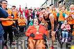 Shane Finn arriving in his hometown Dingle after running 24 marathons in 24 days in aid of Spina Bifida & Hydrocephalus Ireland greeted by his cousin Mary Evans, his famiy and supporters.
