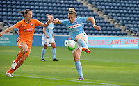 Chicago Red Star forward Ella Masar (3) shoots in front of Sky Blue FC defender Danielle Johnson (15).  The  Chicago Red Stars defeated the Sky Blue FC 2-0 at Toyota Park in Bridgeview, IL on July 10, 2010.
