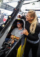 Sep 17, 2016; Concord, NC, USA; NHRA top fuel driver Leah Pritchett with visitors from Kannapolis Fire Department during qualifying for the Carolina Nationals at zMax Dragway. Mandatory Credit: Mark J. Rebilas-USA TODAY Sports