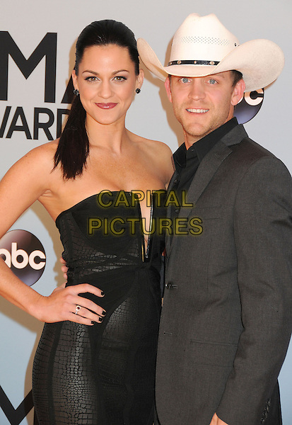NASHVILLE, TENNESSEE - NOVEMBER 06: guest &amp; Justin Moore at the 47th CMA Awards, Country Music's Biggest Night, held at Bridgestone Arena on November 6th, 2013 in Nashville, Tennessee, USA.<br /> CAP/ADM/BP<br /> &copy;Byron Purvis/AdMedia/Capital Pictures
