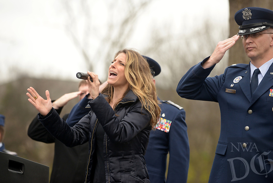 NWA Democrat-Gazette/BEN GOFF @NWABENGOFF<br /> Janine Stange sings the national anthem on Saturday Dec. 12, 2015 during the Wreaths Across America ceremony at Fayetteville National Cemetery. Family members and volunteers with various veterans and community groups helped place a balsam remembrance wreath on the grave of each veteran at the cemetery as part of National Wreaths Across America Day.