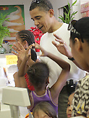 Honolulu, HI - December 26, 2008 -- United States President-elect Barack Obama shares a moment with Sasha, his youngest daughter, at Kokonuts Shave Ice and Snacks at Koko Head Marina shopping mall Friday, December 26, 2008 in Honolulu, Hawaii. .Credit: Kent Nishimura - Pool via CNP