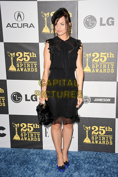 MENA SUVARI.The 25th Annual Film Independent Spirit Awards at the LA Live Event Deck in Los Angeles, California, USA..March 5th, 2010  .full length black ruffle trim ruffle sheer see thru through dress hat sleeveless blue pointy shoes heels bag  .CAP/ROT.©Lee Roth/Capital Pictures