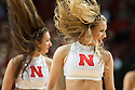 December 4, 2013: Nebraska Scarlets dance team entertaining the fans during a timeout in the game against the Miami (Fl) Hurricanes at the Pinnacle Bank Areana, Lincoln, NE. Nebraska defeated Miami 60 to 49.