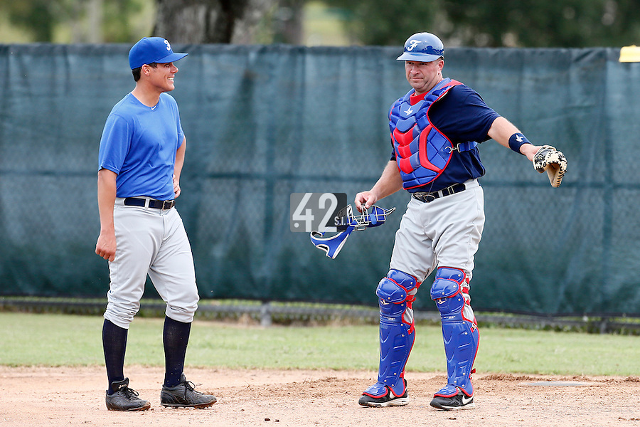 19 September 2012: France Boris Marche listens to Ray Fagnant prior to Team France friendly game won 6-3 against Palm Beach State College, during the 2012 World Baseball Classic Qualifier round, in Lake Worth, Florida, USA.