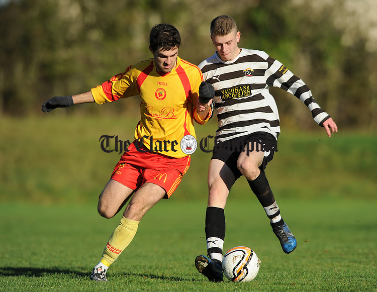 Jack Arra of Avenue Utd B in action against Jimin Dooley of  Moher Celtic during their game at Roslevan. Photograph by John Kelly.