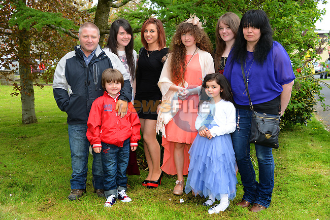 Bethany Conlon pictured after her confirmation at Holy Family Church, Ballsgrove on Saturday with her parents James and Bernie, sisters Talia, Kayleigh, and Hannah, brother James and niece Emily. Photo: Andy Spearman. www.newsfile.ie
