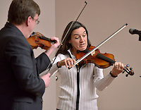 STAFF PHOTO BEN GOFF  @NWABenGoff -- 12/13/14 Judy Williamson of Springdale performs a violin duet with instructor Will Bush during the Will Bush Violin Studio holiday recital at the Shiloh Museum of Ozark History in Springdale on Saturday Dec. 13, 2014.