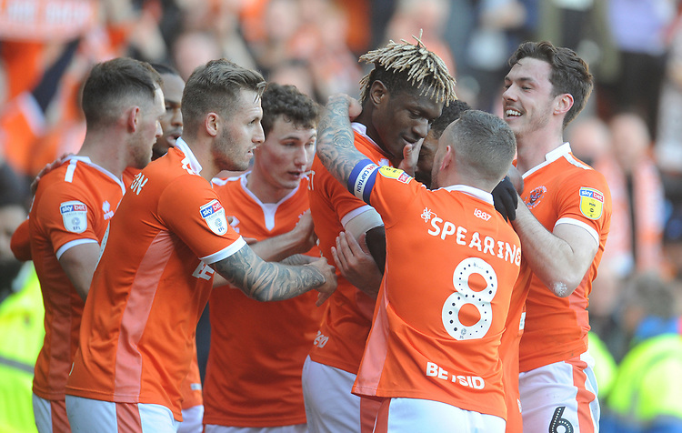Blackpool's Armand Gnanduillet celebrates scoring the opening goal celebrates scoring his side's first goal with team-mates<br /> <br /> Photographer Kevin Barnes/CameraSport<br /> <br /> The EFL Sky Bet League One - Blackpool v Southend United - Saturday 9th March 2019 - Bloomfield Road - Blackpool<br /> <br /> World Copyright © 2019 CameraSport. All rights reserved. 43 Linden Ave. Countesthorpe. Leicester. England. LE8 5PG - Tel: +44 (0) 116 277 4147 - admin@camerasport.com - www.camerasport.com