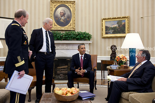 United States President Barack Obama and Vice President Joe Biden meet with General Martin Dempsey, Chairman of the Joint Chiefs of Staff, and Secretary of Defense Leon Panetta in the Oval Office, February 28, 2012.  .Mandatory Credit: Pete Souza - White House via CNP