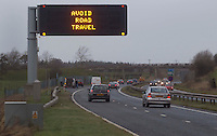 A road sign over the M77 tells drivers to stay off the roads as a major winter storm moves in over Scotland..The Met Office has issued its highest warning, a red alert..Hundreds of schools have been shut and bridge and road closures are causing disruption. 90mph winds are expected..Parts of England and Northern Ireland are also being hit by extreme wind and rain..Picture: Universal News And Sport (Scotland). 8 December 2011. www.unpixs.com.