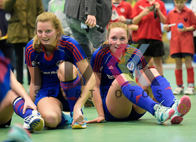 GER - Luebeck, Germany, February 07: Players of Mannheimer HC celebrate after winning the shootout during the 1. Bundesliga Damen indoor hockey final match at the Final 4 between Mannheimer HC (blue) and Duesseldorfer HC (white) on February 7, 2016 at Hansehalle Luebeck in Luebeck, Germany. Final score 6-4 after shootout.  (R-L) Nike Lorenz #16 of Mannheimer HC, Laura Bassemir #25 of Mannheimer HC<br /> <br /> Foto &copy; PIX-Sportfotos *** Foto ist honorarpflichtig! *** Auf Anfrage in hoeherer Qualitaet/Aufloesung. Belegexemplar erbeten. Veroeffentlichung ausschliesslich fuer journalistisch-publizistische Zwecke. For editorial use only.