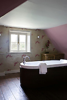 Bath tub in loft ensuite bathroom