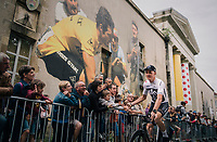 After being attacked in public by former cycling legend Bernard Hinault in the weeks preceeding the Tour  start, Chris Froome (GBR/SKY) now rolls past a huge mural of 'The Badger' at the Team presentation in La Roche-sur-Yon.<br /> <br /> Le Grand D&eacute;part 2018<br /> 105th Tour de France 2018<br /> &copy;kramon