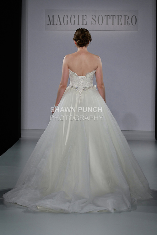 Model walks runway in a Gracelyn wedding dress from the Sottero and Midgley Spring 2013 collection, at The Couture Show, during New York Bridal Fashion Week, on October 14, 2012.